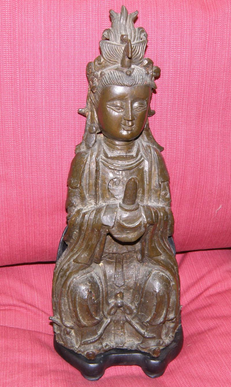 A Ming Dynasty Buddhistic Bronze with traces of original gilt decoration    SOLD