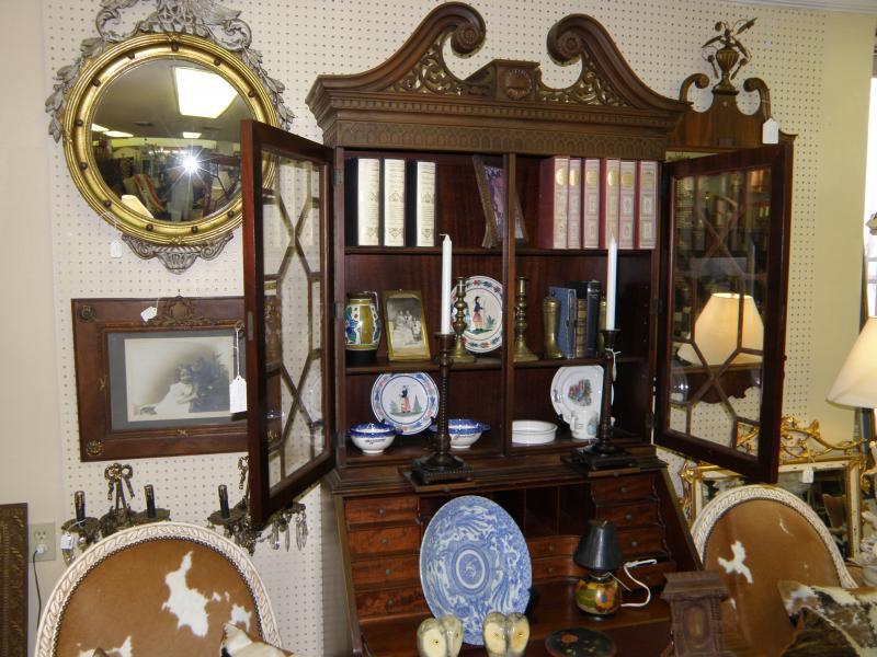 China cabinet and cowhide chairs