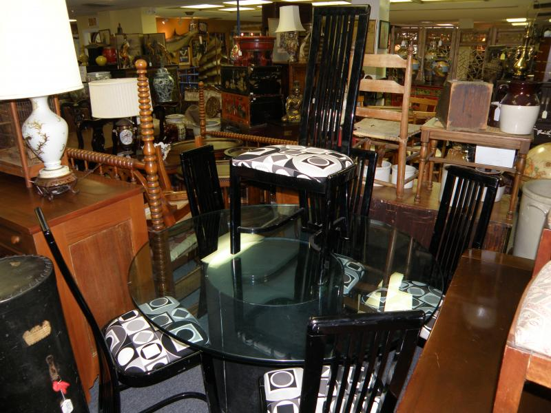 Six Black Chairs and Round Glass Table