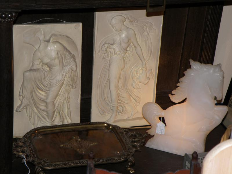 Pair of high relief plaques