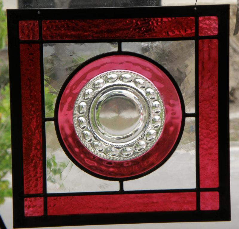 Ruby plate mounted in stained glass frame. Created by one of our artisans.