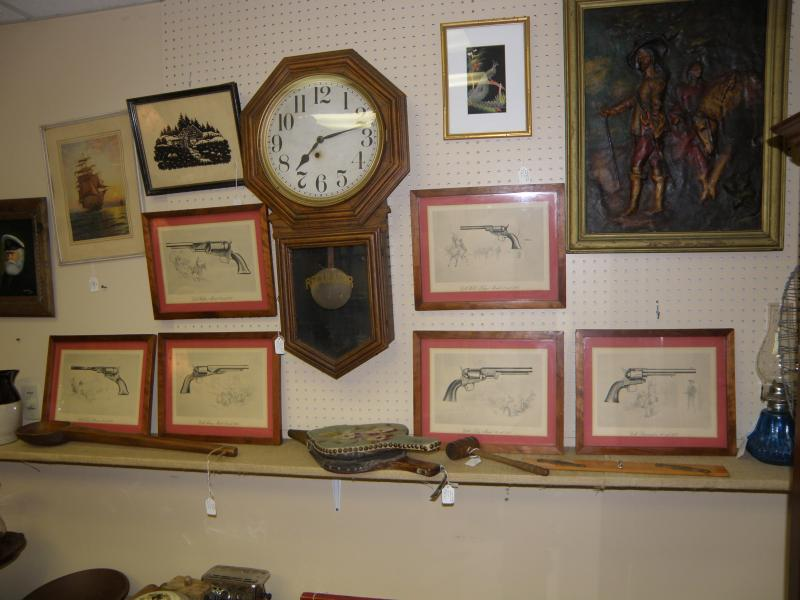 Set of six Colt Pistol Framed Pictures