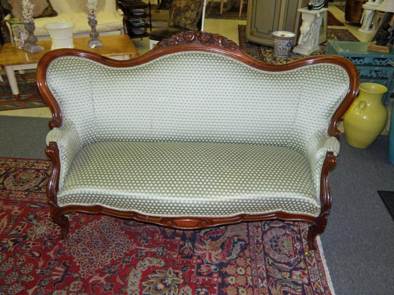 Victorian Walnut Highly Camel Back Carved Settee